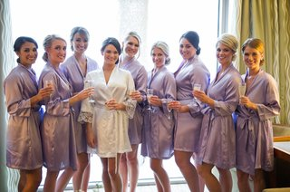 bridesmaids-in-purple-robes-in-bridal-suite