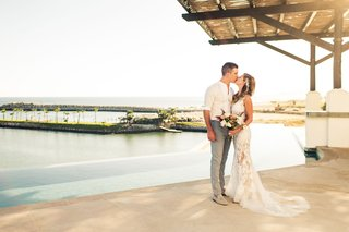 bride-in-lace-yolancris-gown-groom-in-dress-shirt-and-grey-slacks-cabo-san-lucas-wedding