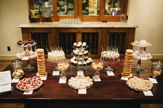 wedding-dessert-table-with-donuts-cupcakes-brownies-blondies-fruit-tarts