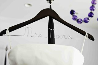 bridal-gown-hanging-on-hanger-with-mrs-personalization