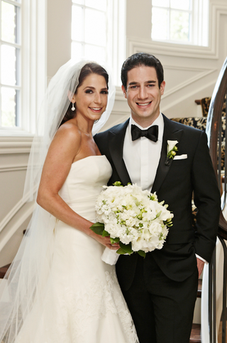 bride-and-groom-in-formalwear-at-bottom-of-staircase
