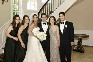 bride-and-groom-with-family-in-formal-attire