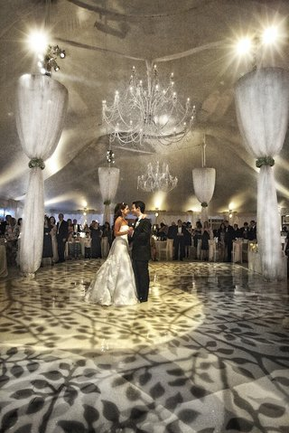 bride-and-groom-first-dance-in-tent-wedding-with-chandeliers