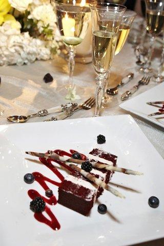 slice-of-red-velvet-cake-with-blueberry-and-blackberry-garnish