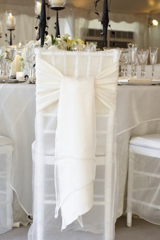 white-fabric-on-back-of-chair-tied-into-loose-bow