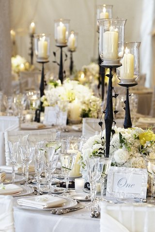 classic-white-reception-decorations-with-branch-candleholder
