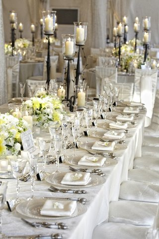 tent-wedding-rectangular-table-with-white-flowers-and-candles