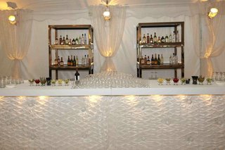 bar-area-with-tufted-fabric-bar-and-white-drapery