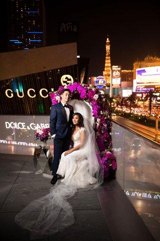 bride-in-cristiano-lucci-wedding-dress-bride-and-groom-on-throne-las-vegas-strip