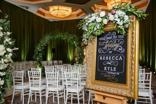wedding-ceremony-sign-gold-frame-chalkboard-art-welcome-to-the-wedding-wedding-date-greenery-flowers