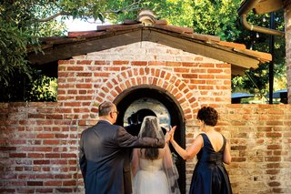 bride-with-wedding-dress-and-veil-going-through-brick-wall-jewish-ceremony-processional