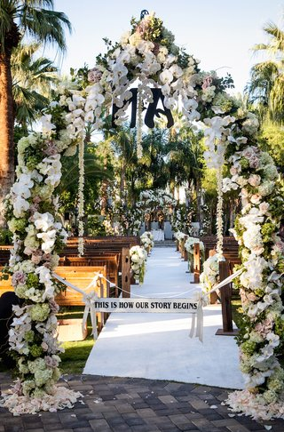 flower-arch-with-this-is-how-our-story-begins-sign