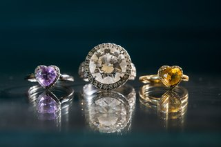 round-diamond-engagement-ring-with-halo-and-two-rings-for-daughter-purple-and-yellow-heart-shaped