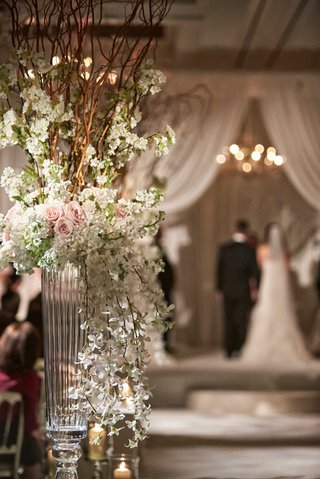 wedding-ceremony-aisle-flower-arrangement-with-glass-vase-and-branches-white-pink-flowers