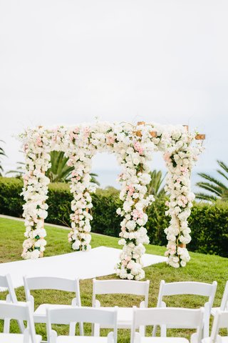 bel-air-bay-club-wedding-outdoor-wedding-ceremony-on-lawn-chuppah-covered-in-flowers