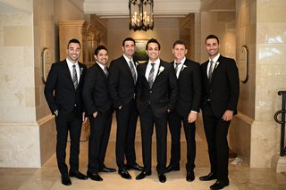 groom-with-groomsmen-in-tuxedos-and-dress-shoes