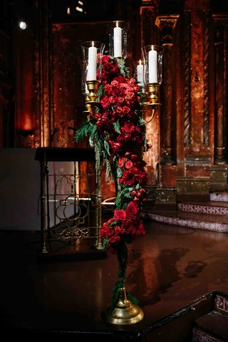 wedding-ceremony-with-tall-golden-candelabra-with-red-roses-and-greenery