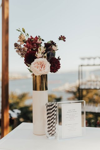 outdoor-cocktail-hour-pink-and-burgundy-rose-flowers-dahlia-white-gold-vase-black-white-stripe-straw