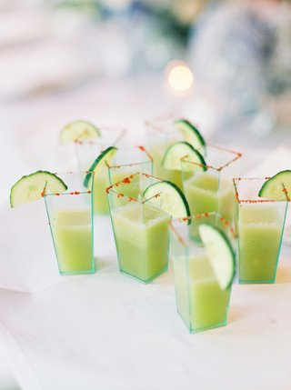 geometric-shot-glasses-filled-with-cucumber-gazpacho-green-soup-smoothie-with-red-rim