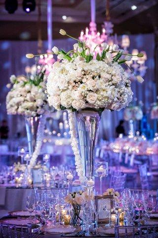 wedding-reception-centerpiece-light-pink-rose-white-hydrangea-white-tulip-flowers-purple-lights