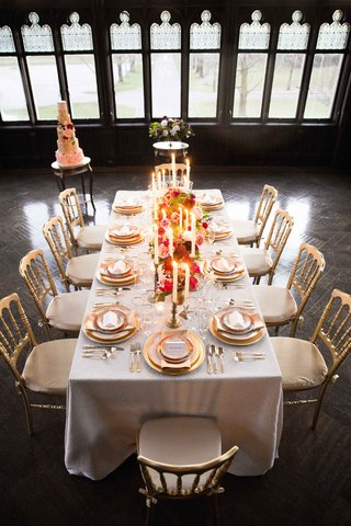 white-gold-tablescape-pops-of-color-vintage-wedding-styled-shoot-inspiration-candles-cake-hempstead