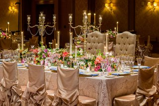 rectangle-table-with-tufted-wedding-throne-chairs-candelabra-chair-covers-candlelight