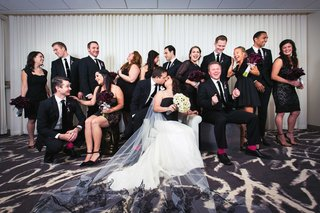 bride-and-groom-with-their-bridesmaids-and-groomsmen-in-mostly-black-attire