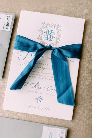 wedding-invitation-letterpress-torn-edge-paper-blue-ribbon-blue-silver-grey-monogram-script