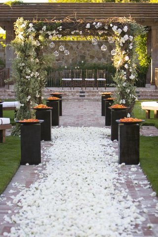 brick-aisle-with-white-roses-and-rustic-chuppah