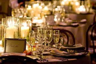 vineyard-wedding-tablescape-with-candles-and-wine-table-name