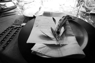 black-and-white-photo-of-olive-branch-at-wedding-place-setting