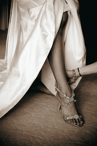 sepia-tone-picture-of-strappy-manolo-blahnik-wedding-shoes