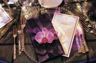 silver-bead-charger-plate-with-purple-napkin-and-orchid