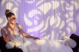 bride-reclining-wedding-gown-pallas-couture-australian-bridal-designer-deep-v-overskirt-beading