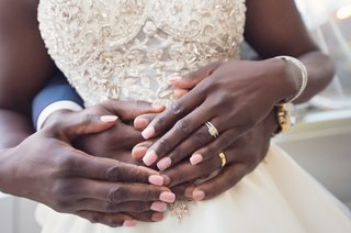 african-american-bride-with-pink-manicure-and-rhinestone-decals-yellow-gold-mens-wedding-band
