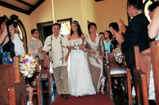 bride-and-parents-walk-down-aisle-at-tropical-ceremony
