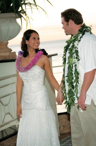 bride-wearing-pink-lei-and-groom-wearing-green-lei