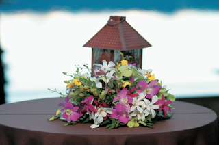 brown-lantern-and-colorful-flowers-on-table