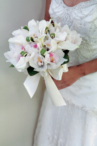 bridal-bouquet-of-lilies-orchids-and-palm-fronds