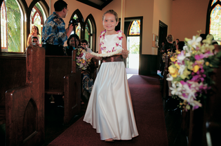 flower-girl-wearing-white-long-dress-and-pink-lei