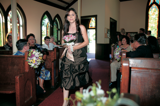 bridesmaid-walks-down-the-aisle-at-ceremony-in-hawaii