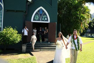bride-and-groom-leave-church-after-ceremony-in-hawaii