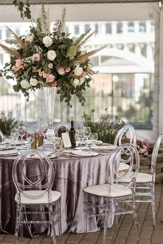 boho-chic-wedding-reception-clear-tent-velvet-purple-linen-acrylic-oval-chair-tall-centerpiece