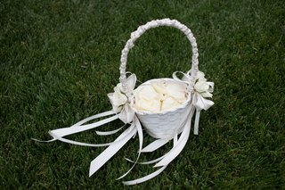 white-flower-girl-basket-with-ivory-rose-petals-and-white-ribbon