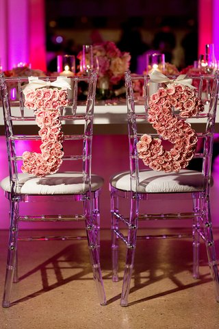 initials-formed-out-of-pink-roses-attached-to-back-of-chairs