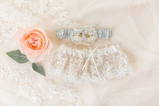 wedding-garters-on-lace-veil-white-lace-ribbon-and-light-something-blue-garter