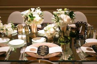 mirror-tablescape-black-gold-details-centerpieces-green-white-menus-charger-modern-wedding