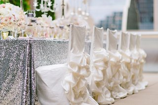 wedding-reception-chairs-with-white-chair-covers-and-ruffle-skirts