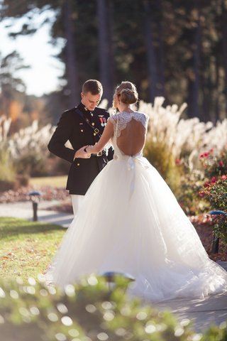 bride-in-monique-lhuillier-wedding-dress-and-groom-in-military-uniform