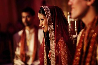 indian-wedding-bride-at-ceremony-with-red-and-gold-attire
